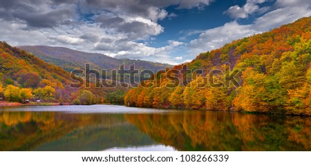 Colorful autumn landscape in the mountains with lake - stock photo