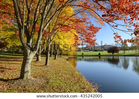 Colorful Autumn Landscape of Lake in Park - stock photo