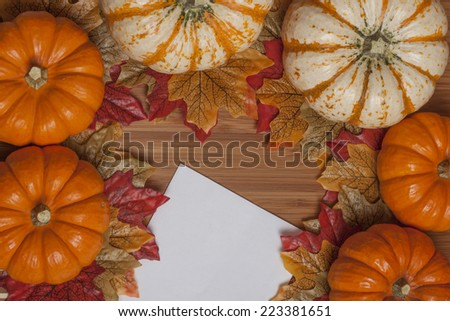 Colorful autumn maple leave wreath on wooden background