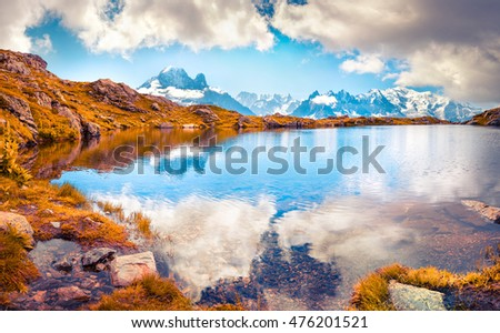 Colorful autumn morning on the Lac Blanc lake with Mont Blanc (Monte Bianco) on background, Chamonix location. Beautiful outdoor scene in Vallon de Berard Nature Preserve, Graian Alps, France, Europe