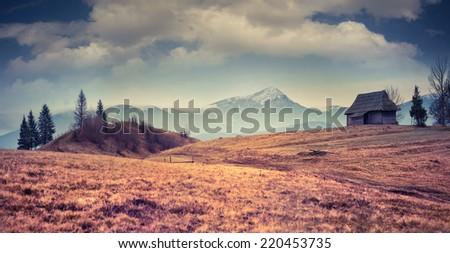 Colorful autumn panorama of the mountain village. Retro style. - stock photo