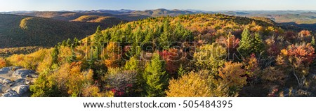 Colorful Autumn panoramic view North over Spruce and West Mountains from the Hadley Mountain fire tower in the Adirondack Mountains of New York
