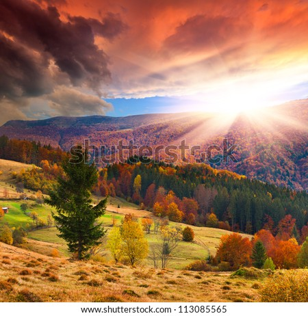Colorful autumn sunset in the mountains - stock photo