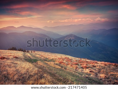 Colorful autumn sunset in the mountains. Retro style. - stock photo