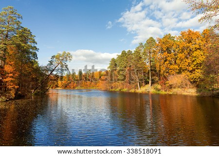 Colorful autumn trees fortress at the river front - stock photo