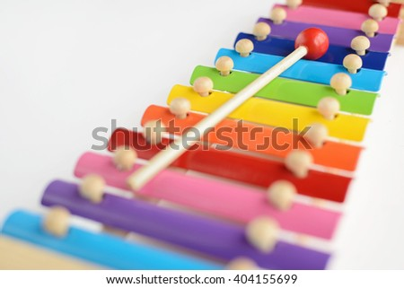 Colorful baby toy xylophone with stick isolated over white background - stock photo