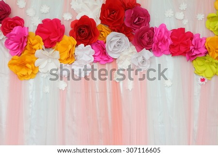 Colorful backdrop paper  flower with fabric arrangement  by handmade ready for wedding ceremony.
