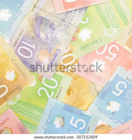 Colorful background and texture of Canadian dollars banknotes - stock photo