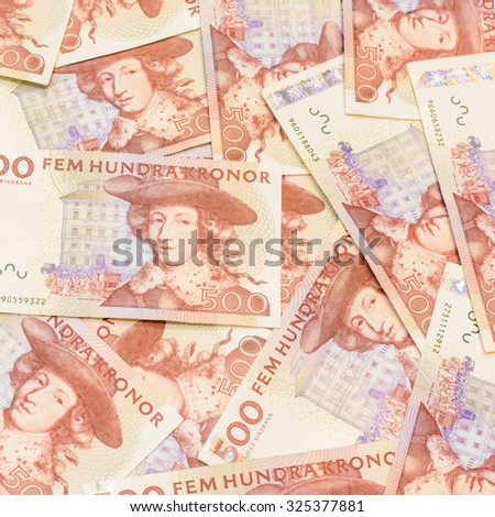 Colorful background and texture of five hundred Swedish Krona currency,money got profit from business - stock photo