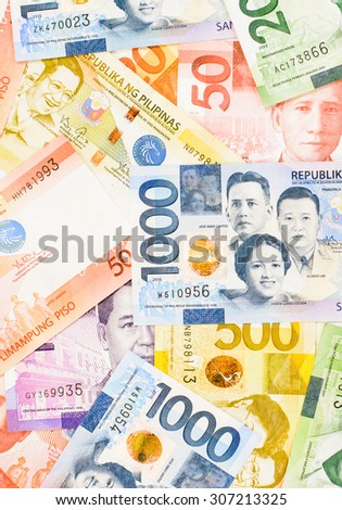 Colorful background and texture of Philippines money banknotes - stock photo