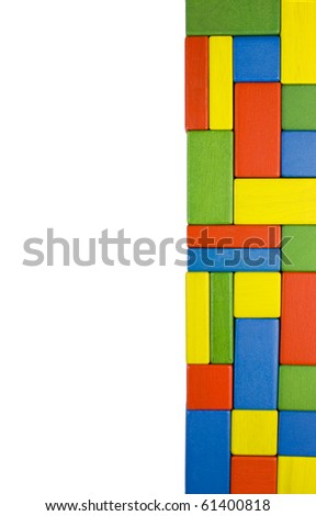 Colorful background created of red, yellow, green and blue wooden toy blocks arranged into a narrow stripe. - stock photo
