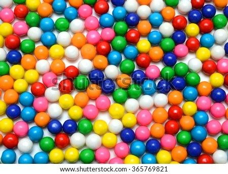 Colorful background of assorted shiny round gumballs - stock photo