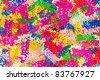 Colorful background of multicolored happy birthday confetti pieces - stock photo