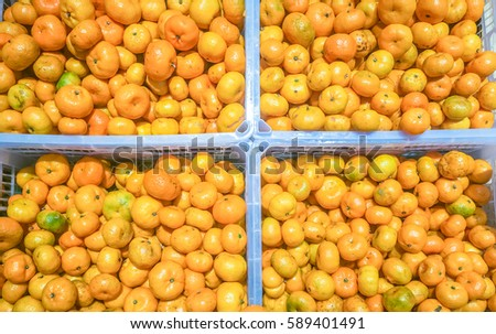 Colorful background Of Oranges In Fruit Market,Fresh mandarin oranges texture in a box