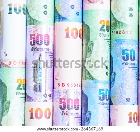 Colorful background  of Thai currency,banknotes roll - stock photo