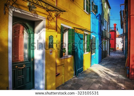 colorful backstreet in Burano, Italy. Processed for hdr tone mapping effect. - stock photo