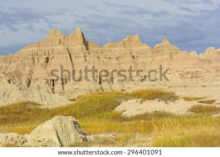 Colorful Badlands Formations Against Stormy Skies in Badlands National Park in South Dakota - stock photo