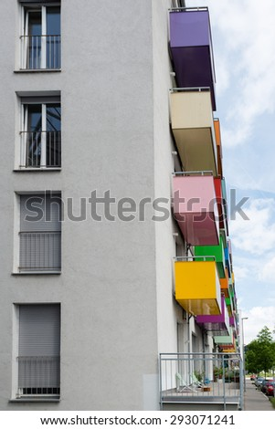 Colorful balconies on a modern apartment building  against great blue sky - stock photo
