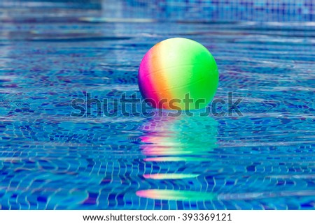 colorful ball floating in a pool
