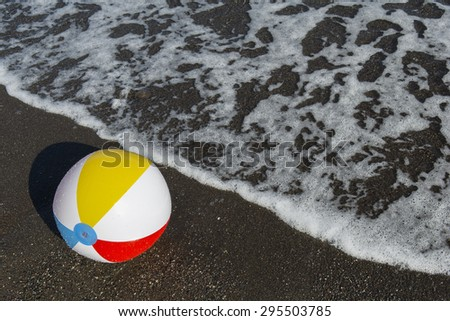 colorful ball on the seashore. Focus on ball
