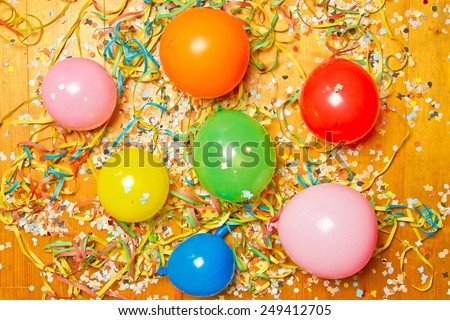 Colorful balloons and party decoration on wooden floor - stock photo