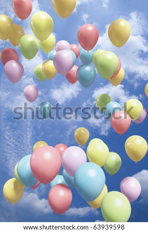 Colorful balloons flying in the air - stock photo
