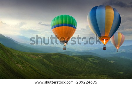 Colorful balloons flying in the mountain - stock photo