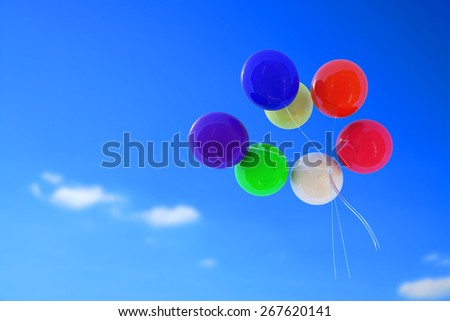 colorful balloons flying up to the sky