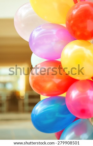 Colorful balloons in children's party - stock photo