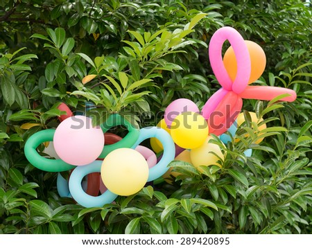 Colorful balloons in magnolia branches. - stock photo