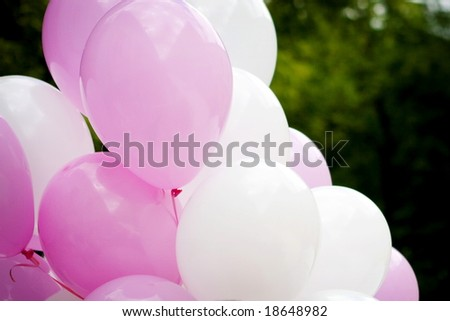Colorful balloons on a nature background - stock photo