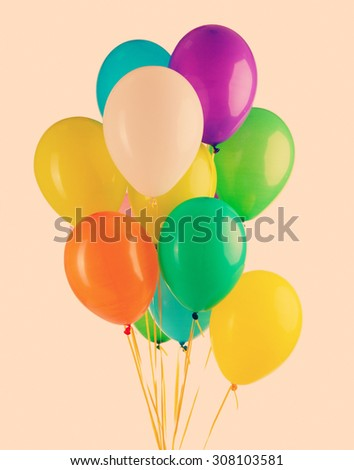 Colorful balloons on color background - stock photo