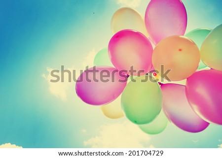 Colorful Balloons on Retro Vintage Sky - stock photo
