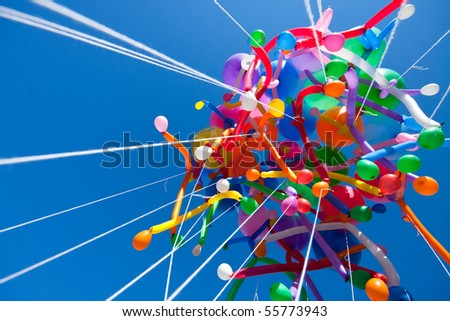 Colorful balloons on sky - stock photo