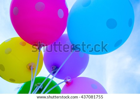 Colorful balloons on the sky background, bright air balloons on sky, festive air balloons - sight from below, air balloons above head, yellow, blue, pink, purple air balloon image, bunch of balloons - stock photo