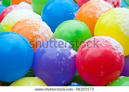 colorful balloons with snow on it - stock photo