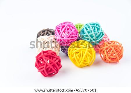 colorful balls of hemp twine on white background - stock photo