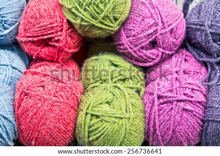Colorful balls of wool as a background - stock photo