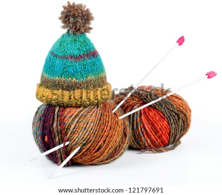 Colorful balls of wool with knitting needles isolated on white - stock photo