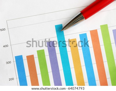 Colorful bar graph and red pen - stock photo