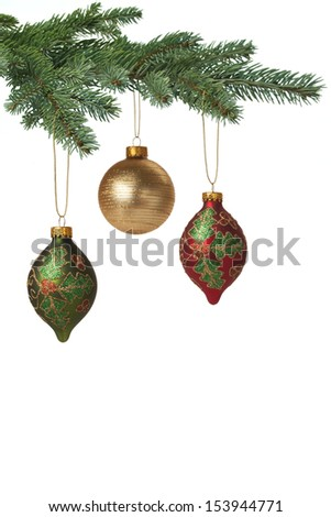 Colorful baubles hanging on Christmas tree for holiday background. With copy space. - stock photo