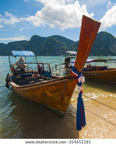 Colorful beach and wooden tailboats moored in Phi Phi Island, Thailand. - stock photo