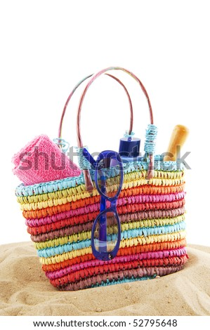 colorful beach bag packed for the summer vacation - stock photo