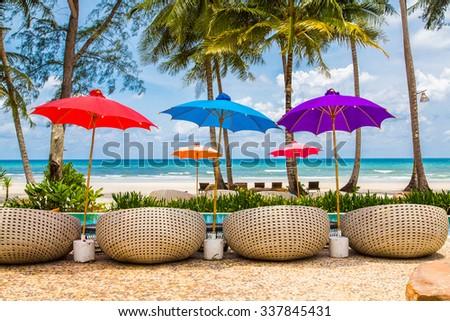 Colorful beach beach umbrella with blue sea and sky  - stock photo