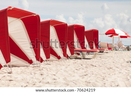 Colorful beach cabanas along the popular South Beach in Miami. - stock photo