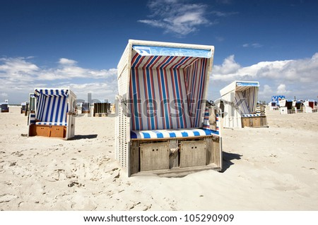colorful beach chairs at the beach of Sankt Peter Ording,  North Sea - stock photo