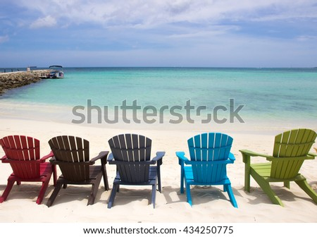 colorful beach chairs  on caribbean coast