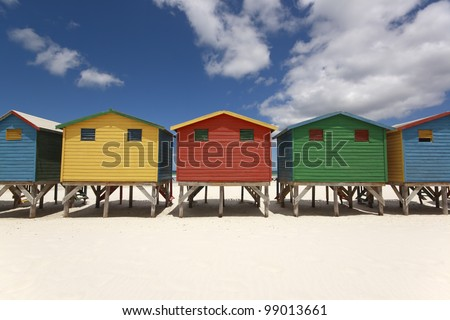 Colorful beach huts (changing cabins) on the Muizenberg Beach near Cape Town. - stock photo