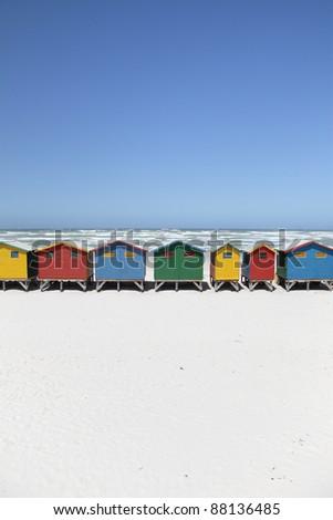 Colorful Beach Huts on Beach - stock photo