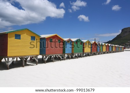 Colorful beach huts on the Muizenberg Beach near Cape Town. - stock photo